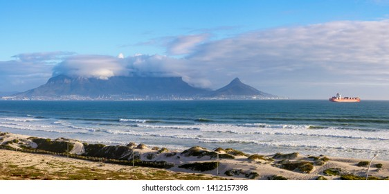 Ocean view of Table Bay, Cape Town, Table Mountain, Devil's Peak and Lion's Head from Blouberg. Cape Town . Western Cape. South Africa.