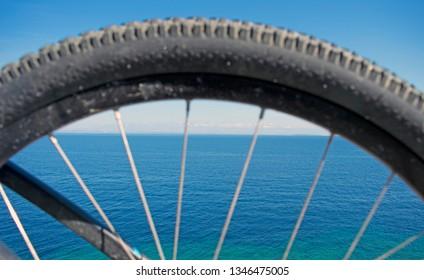 Ocean view through bike rim