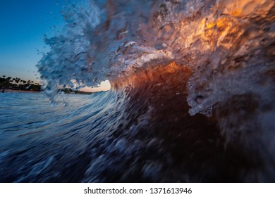 Ocean wave action shot with sun backlighting through the water
