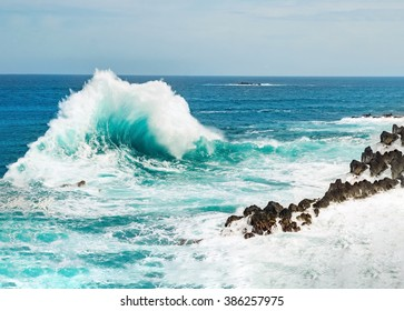 Ocean wave background breaking sea water rocky shore rough seas turquoise water gradient foam, Porto Moniz Madeira