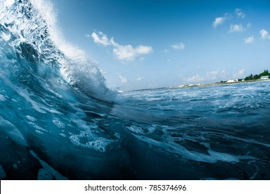 Ocean wave breaking on the shore. Surfspot named Jailbreak, Maldives