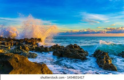 Ocean Wave crash rocks sunrise