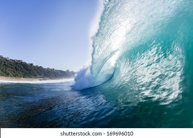Ocean Wave Crashing Swimming Ocean Waves Crashing Ocean wave swells surging forward and crashing onto shallow reefs and sandbars with energy and power
