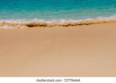 Ocean, waves, beach and sand. Natural textures of the surface of water and sand. The coast of Indian Ocean. Seychelles