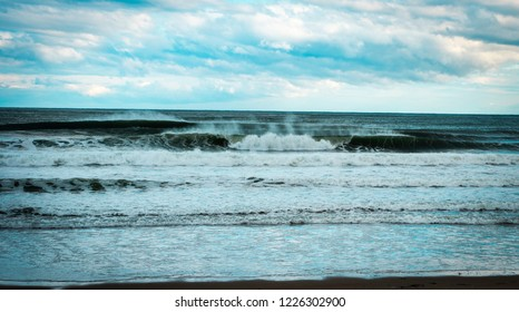 Ocean waves breaking on the Maine coast.