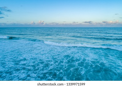 Ocean waves and clear sky at dawn with copy space