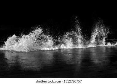 ocean waves crash on shore