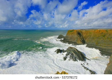 ocean waves crashing on rocks along the sea side of Alentejo region, Portugal