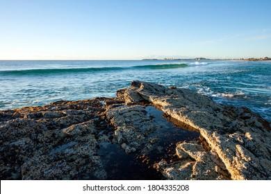 Ocean waves crashing to rocky shore