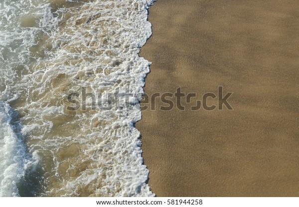 Ocean waves hitting the shore in California