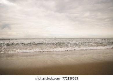 ocean waves on Santa Monica beach in cloudy november day
