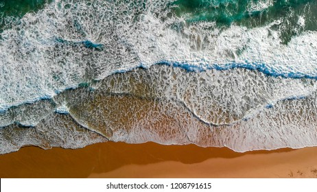 Ocean waves overhead aerial view on a sunny day.