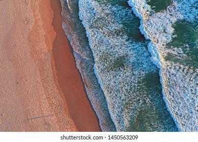 Ocean waves top shot at the beach