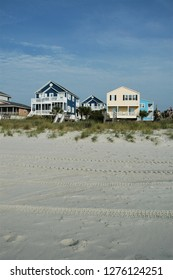 Oceanfront beach rental homes as viewed from the beach.
