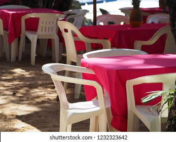Oceanfront restaurant with pink tables