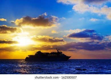 oceanic cruise ship at sunset