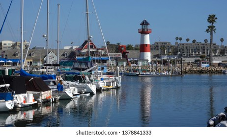 Oceanside, CA / USA - April 22, 2019: Wide shot of the Oceanside Harbor on a sunny day