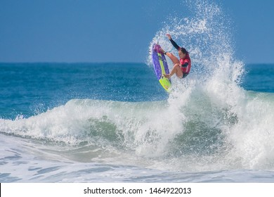 Oceanside CA USA July 27, 2019 Surfer Carissa Moore gets some air at the Nissan Super Girl Pro. This event features the best female surfers from around the world to compete in Southern California.