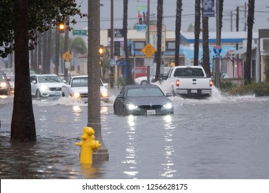 Oceanside, California / 11/08/2018 A Tropical storm comes onshore in Oceanside California just North of San Diego. Vehicles and pedestrians are left stranded when the flood waters reach 3 feet.