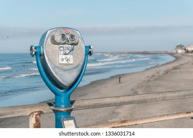 OCEANSIDE, California (EUA) - November 10, 2017: Antique coin operated binoculars at Oceanside Pier, and the beach on the background