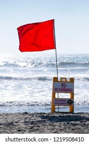 Oceanside California / USA 11-01-2018 A red flag warns swimmers of current ocean conditions and dangers at the beach in Oceanside California.