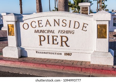 OCEANSIDE, CALIFORNIA/USA - FEBRUARY 24, 2018: Sign marker for the Oceanside Pier placed at the entrance when it was reconstructed in 1987.  The Oceanside pier is located in the city of San Diego.