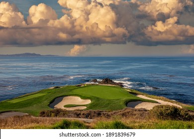 oceanside golf course with bunker,  ocean and clouds