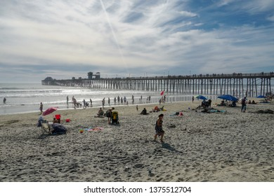 The Oceanside Pier during blue summer day, Oceanside, northern San Diego County, California. Wooden pier on the western United States coastline. Famous for fisher. 03/22/2019