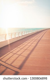 Oceanside walkway good for excercise during a sunny day. Long shadows and a minimalistic view.