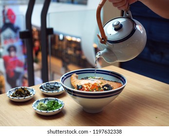 Ochazuke; traditional Japanese meal over 1,000 years. Made with steamed rice add with salted salmon, roe and shitake katsuo kombu dashi or soup and topping  such as nori, arare,green onion and wasabi.