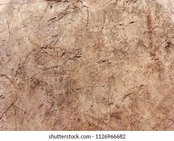 Ocher painting background on a wall of Tuscany
