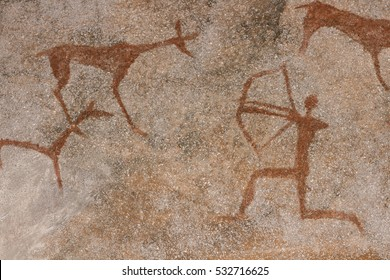 ocher pattern of ancient man on the rock wall of the cave. prehistoric stone age. hunter hunts Ditch.