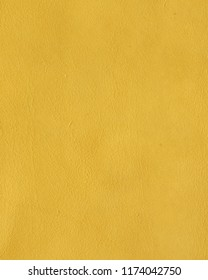 Ocher yellow leather texture background