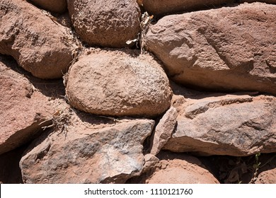 Ochery stone wall structure close-up in the very dry Atacama Desert red