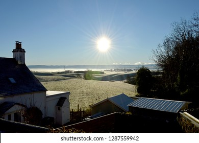 The Ochil Hills from Gilmerton, Perthshire with ground fog and early morning winter sun with sun star and lens flare