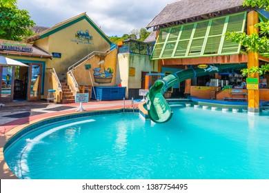 Ocho Rios, Jamaica - April 23 2019: Margaritaville Ocho Rios Jamaica in Saint Ann parish on the beach next to the Cruise Ship Port. Fun tourist location with pool, water slide, store, bar, restaurant.