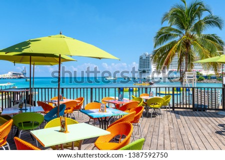 Ocho Rios, Jamaica - April 23 2019: Tropical island Caribbean color chairs & tables : ocho beach chairs - Cheerinfomania.Com