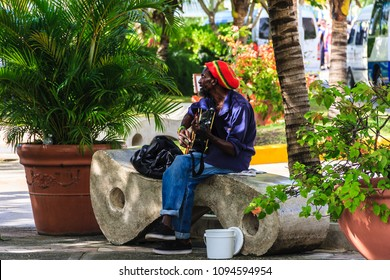 Ocho Rios, Jamaica - February 20, 2018 - Local man was playing guitar songs of Jimy Hendrix near the cruise ship peer