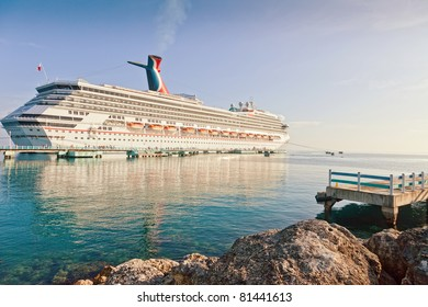 OCHO RIOS, JAMAICA - JULY 14:  Carnival cruise ship docks in Ocho Rios, Jamaica on July 14, 2011, once the most famous Jamaican port, is now losing popularity to the newest port located in Falmouth.