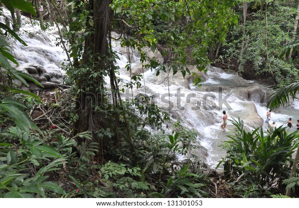 OCHO RIOS, JAMAICA - NOV 21: Tourists climbing the famous Dunns River Falls on November 21, 2012 in Ocho Rios, Jamaica.