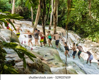 Ocho Rios, Jamaica - November 15, 2016: The Dunn's River Falls are waterfalls in Ocho Rios in Jamaica, which can be climbed by tourists.