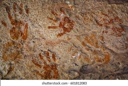 Ochre Hands, Red, Orange, Yellow hand prints on rock, Aboriginal art in Queensland, Australia.