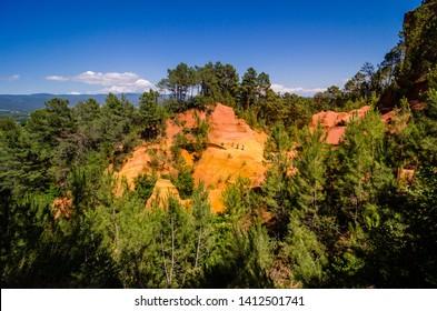 The Ochre Path le Sentier de Ocres through Red Cliffs of Roussillon Les Ocres, nature park in Vaucluse, Provence