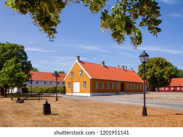 Ochre and red coloured historic buildings at Staverns Fortress (Fredriksvern), Larvik, Vestfold, Norway