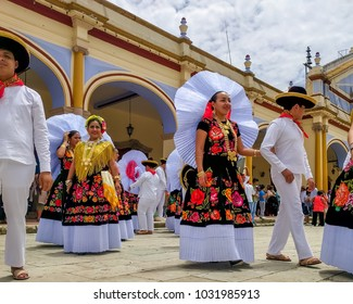 OCOTLAN DE MORELOS, OAXACA, MEXICO-July 24, 2017. Local indigenous Mexicans meeting for the annual Guelaguetza festival. People are wearing colorful regional clothes.