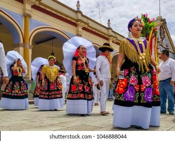 OCOTLAN DE MORELOS, OAXACA, MEX.-July 24, 2017. Women and men gather at the Palacio Municipal in preparation for Guelaguetza celebration.