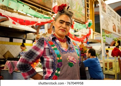 OCOTLAN, MEXICO - CIRCA OCTOBER 2017: Portrait of Mexican artist Frida Kahlo 's lookalike who works as a cook in the traditional market of Ocotlan, Oaxaca.