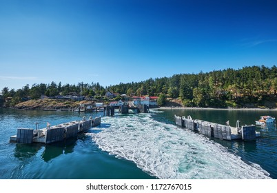 Ocras Island ferry dock with wake of departing ferry