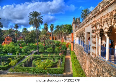 OCT 11, SEVILLE, SPAIN: HDR photo of the beautiful amazing gardens in Reales Alcazares in Seville - residence developed from a former Moorish Palace in Andalusia, Spain, Oct 11, 2015