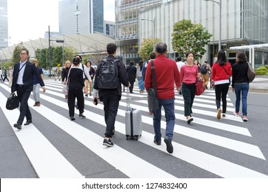 OCT 11th 2018, TOKYO: Japanese people walking across the road at business district, TOKYO JAPAN